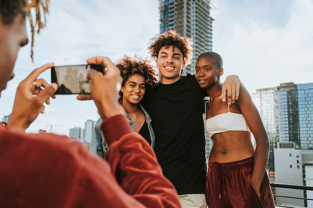 Guy taking a photo of his friends at a rooftop