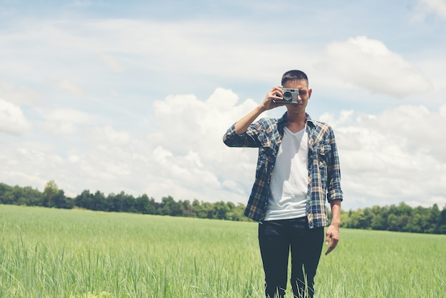 Guy taking a picture with nature background