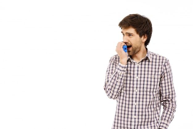 Guy talking via walkie-talkie