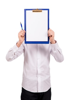 A guy in white clothes on a white background does not look at the camera but shows a blank page