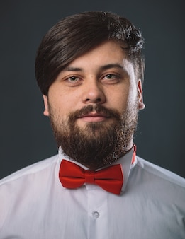 Guy in a white shirt with red tie bow