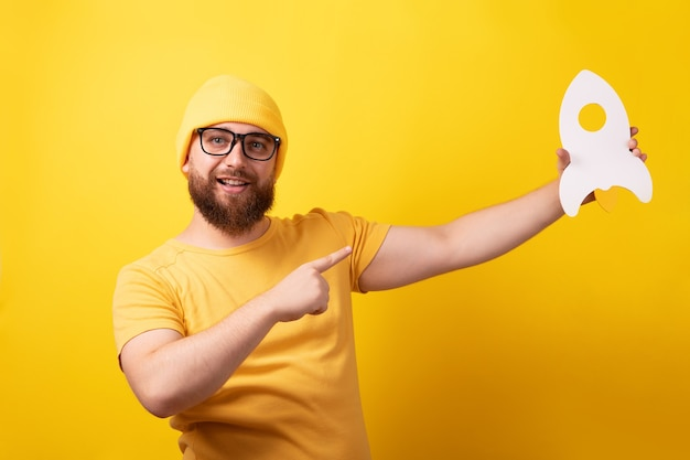 Guy with rocket over yellow background, startup concept