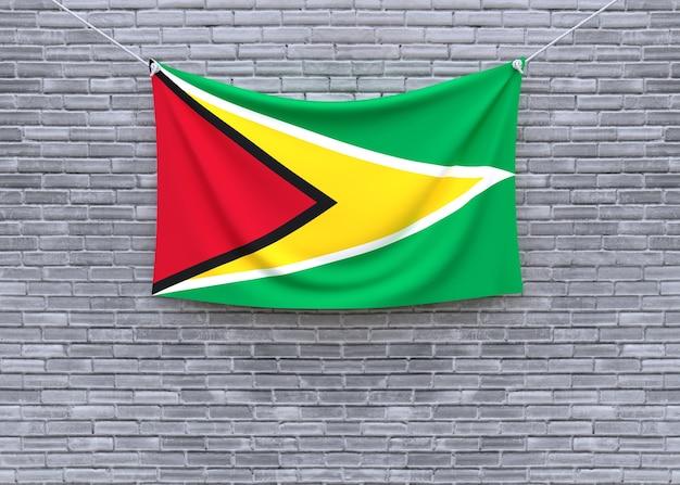 Guyana flag hanging on brick wall