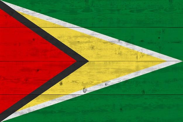 Guyana flag painted on old wood plank