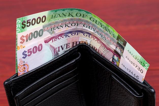 Guyanese dollar in the black wallet