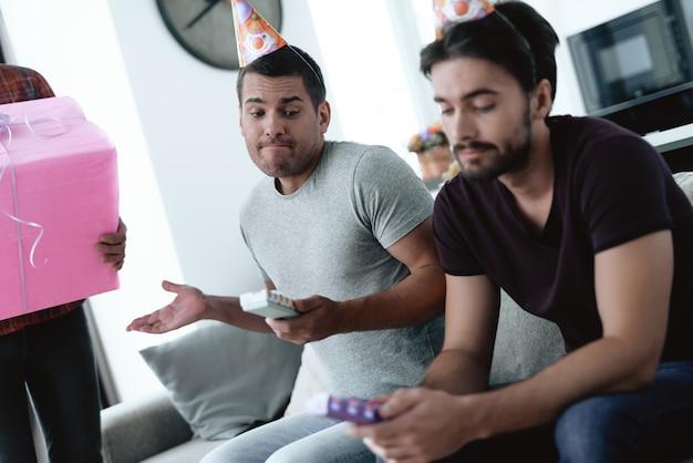 Guys prepare surprise party. man hold giftbox.