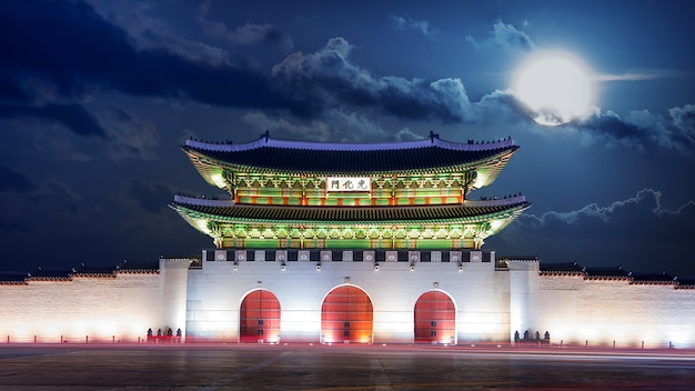 Gyeongbokgung palace and full moon at night in seoul, south korea