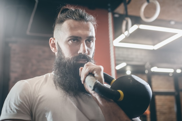 Gym. bearded man training. crossfit.