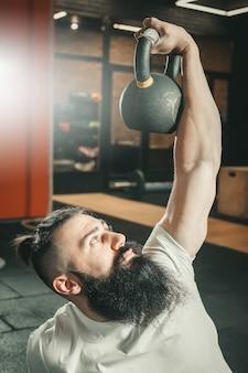 Gym. bearded man training.