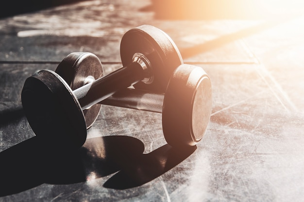 Gym equipment close up dumbbells on floor for background