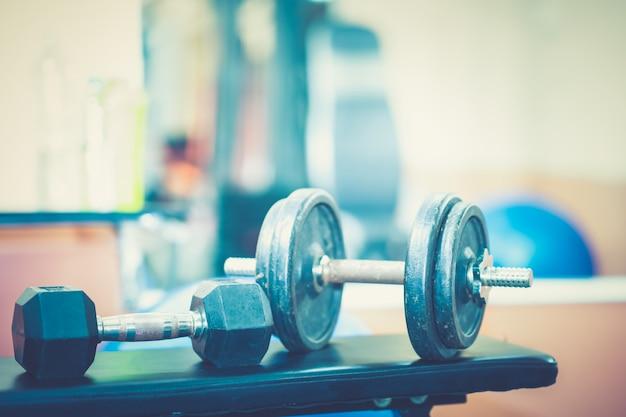 Gym exercise weight training fitness on dumbbells