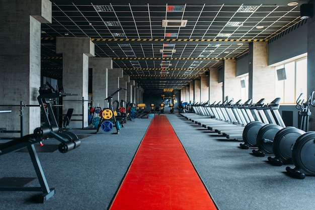 Gym nobody, empty fitness club. gymnastic exercisers. sport center equipment