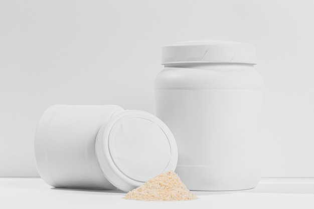 Gym powder supplements jar on table