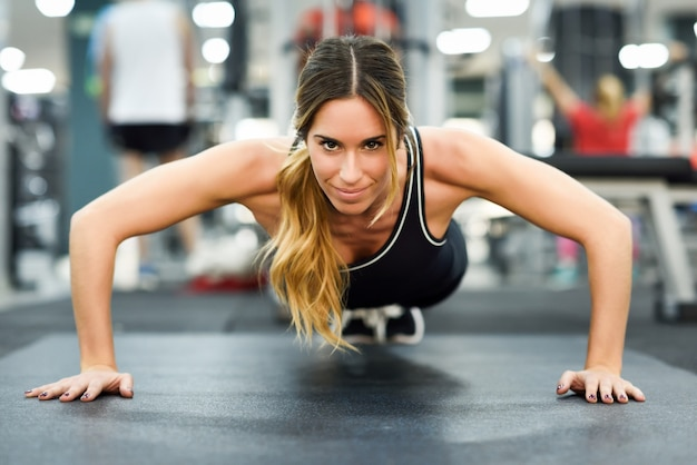 Gym woman muscles health exercise