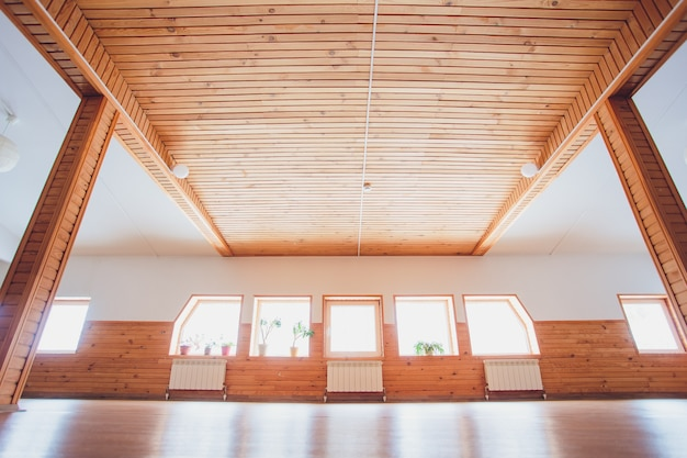 Gym wood interior with black yoga mat and small windows
