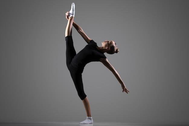 Gymnast girl doing standing splits