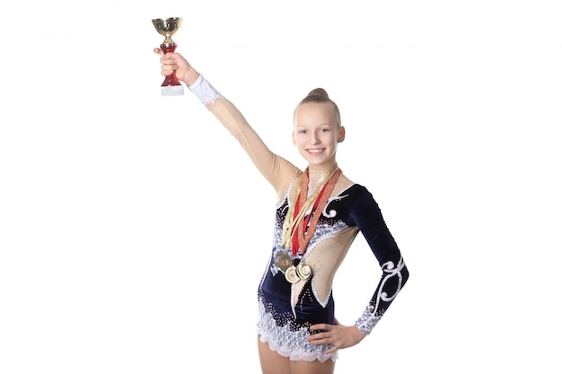 Gymnast girl with golden cup and medals