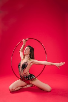 Gymnast making positions with the hoop