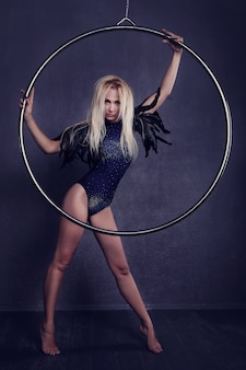 Gymnast on a ring in circus under a dome