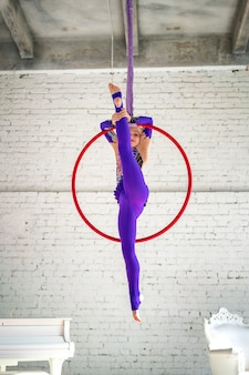 Gymnast on the rings in the air