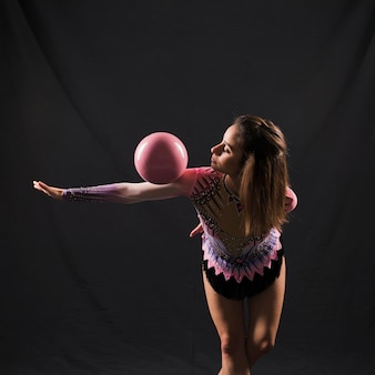 Gymnast using the ball
