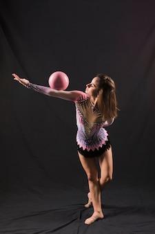 Gymnast using the ball