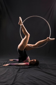 Gymnast using the hoop