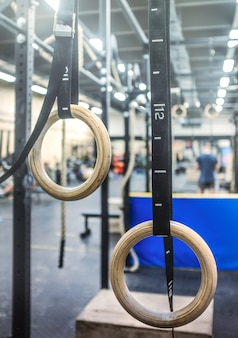 Gymnastic rings in the crossfit zone in the gym