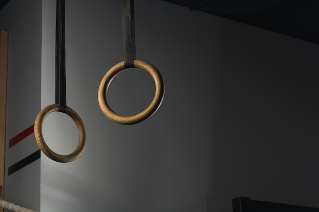 Gymnastic rings suspended on straps on crossfit gym
