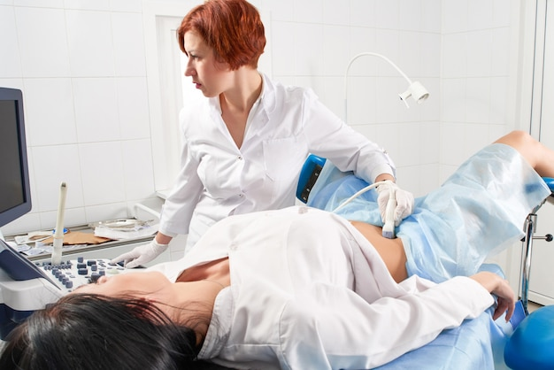 Gynecologist doing ultrasound scanning