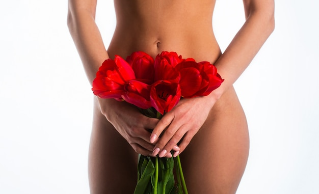 Gynecology concept. young woman flower on white background. gynecology and underwear, women health. youth and freshness, purity, flowering. gynecology, menstruation, concept of woman genital health.