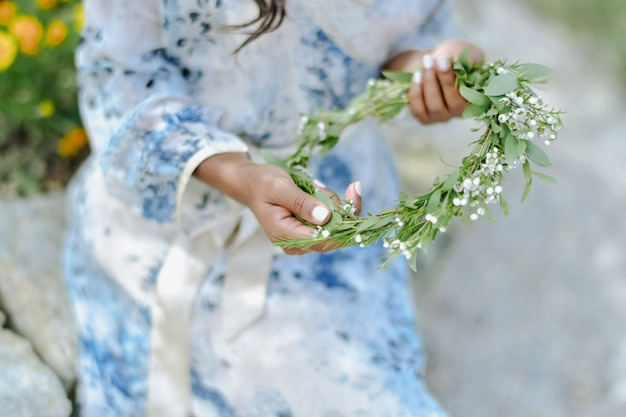 Gypsophila and ruscus wedding wreath, bridal floral crown in hands