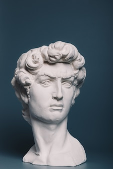 Gypsum copy of the sculpture david michelangelo on gray background