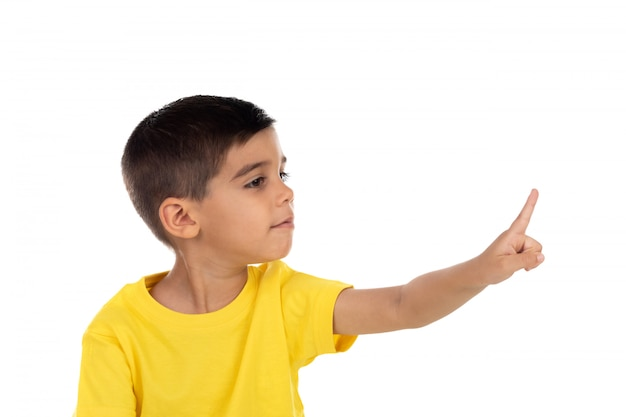 Gypsy child with yellow t-shirt pointing with the hand