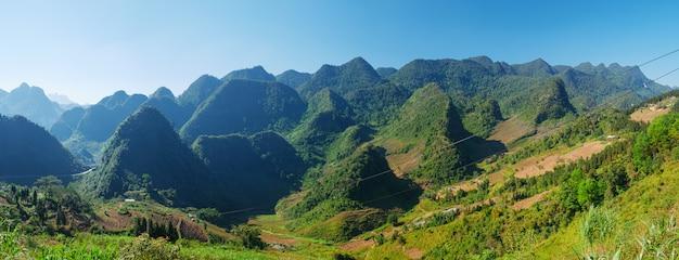 Ha giang karst geopark mountain landscape in north vietnam. winding road in stunning scenery. ha giang motorbike loop, famous destination