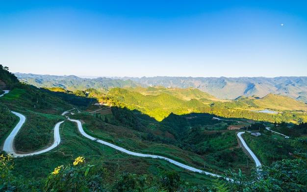 Ha giang karst geopark mountain landscape in north vietnam. winding road in stunning scenery. ha giang motorbike loop