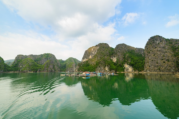 Ha long bay unique limestone rock islands and karst formation peaks in the sea, famous tourism destination in vietnam. scenic blue sky.