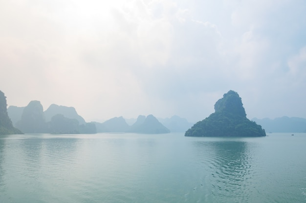 Ha long bay, unique limestone rock islands and karst formation peaks in the sea