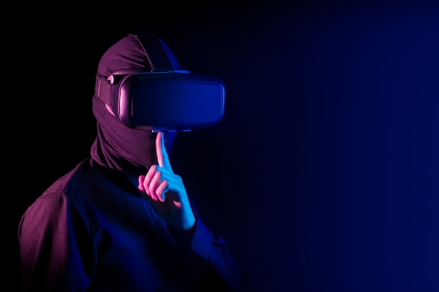 Hacker bad guy with virtual reality glass and digital security internet network concept