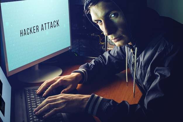 Hacker in the dark breaks the access to steal information