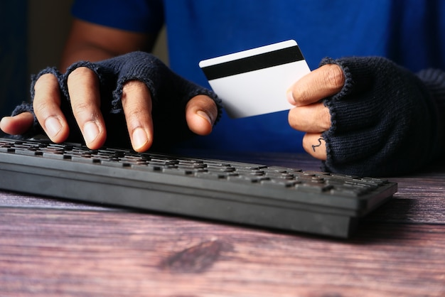 Hacker hand stealing data from credit card