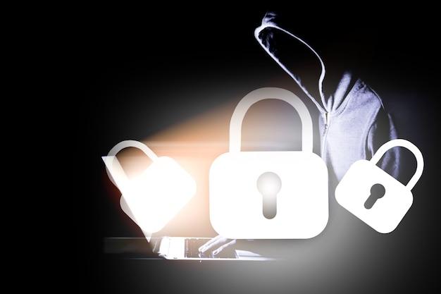 The hacker in the hood breaks the lock