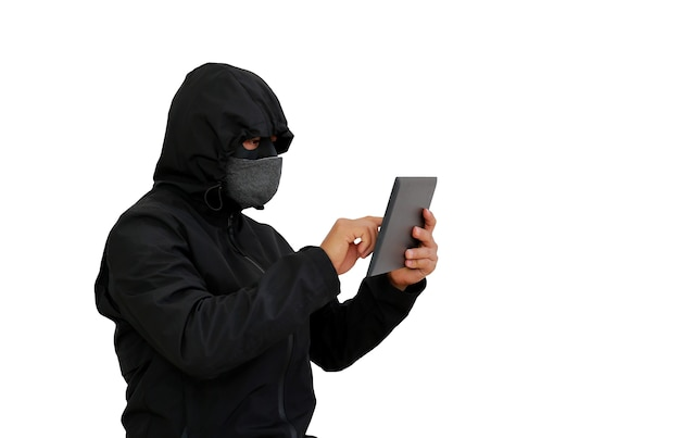 Hacker in hooded using tablet to hacking data isolated over white background