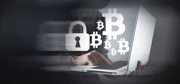 Hacker man using laptop and computer with bitcoin