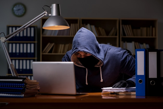 Hacker stealing personal data from home computer