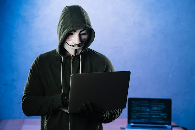 Hacker with anonymous mask