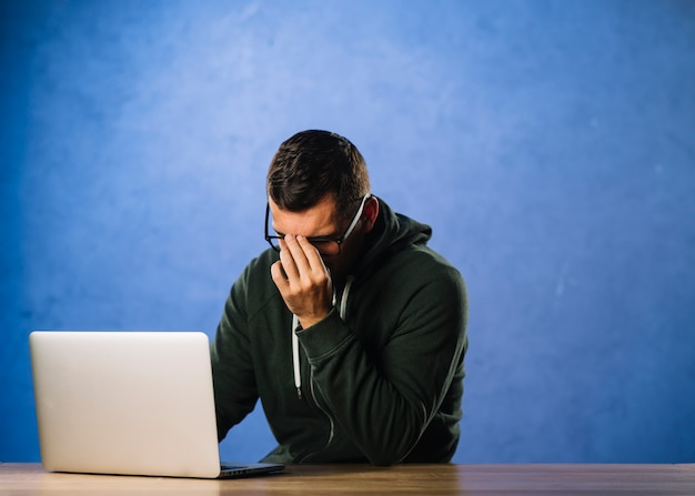 Hacker with desperate or tired expression
