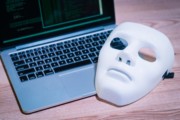 Hackers mask and laptop