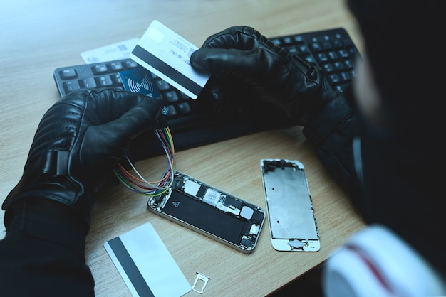 Hacking concept. hacker trying to steal mobile payment information. close up view