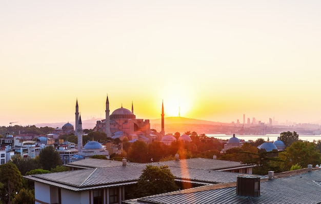 Hagia sophia and istanbul roofs at sunrise, beautiful view.